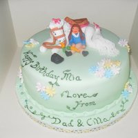 Pony And Child Cake. Cake with pony and child topper.