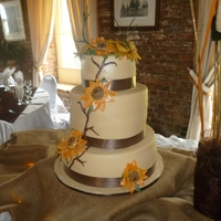 Sunflower Wedding Cake Top and bottom tier traditional west indian fruit cake ,middle tier vanilla with chocolate filling