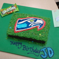 12Th Fan Cake 10 year old Seahawk lover wanted his team logo on a cake with pink. Pulled together this one on the fly, GO HAWKS!