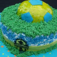 Sounders Soccer Chocolate and vanilla buttercream cake for a child's 7th birthday. Soccer ball is made with RKT and covered in fondant . The Seattle...
