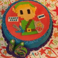 Legend Of Zelda *Legend of Zelda's Link on a chocolate/chocolate cake. Fondant around the candles and handcut in pixels for the character. Rubber...