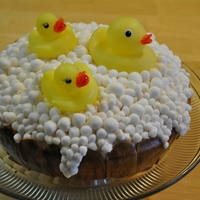 Rubber Ducky I used fondant to make the bubble and the barrel. To make the barrel look like wood I used a paint brush dipped in brown icing.