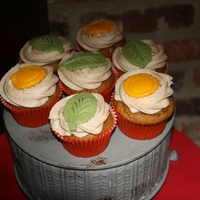 Fall Colored Cupcakes These are pumpkin cupcakes with cinnamon cream cheese icing and a fondant decoration on top. They disappeared quickly, so they must have...