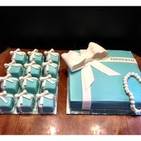 Tiffany Gift Box Cake And Ring Box Cupcakes  These are covered in fondant. I ended up using mirrors as the cake boards to fancy them up a little more and added sugar pearls around the...