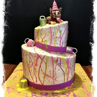 Kitty Cat Paint Splatter Topsy Turvy Cake The cat is made of out modeling chocolate, Paint cans are fondant. The paint splatters are thinned out royal icing.