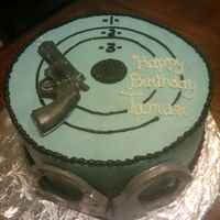 Mrs. Officer  Cake was made for a police woman. I didn't want it to look masculine so I went with the baby blue. Gun and handcuffs made with candy...