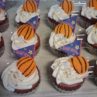 Slam Dunk!   Strawberry cupcakes with strawberry flavored buttercream and fondant basketball!