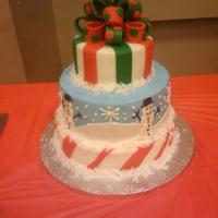 1St Christmas Cake This is my 1st 3 tiered cake and first bow. The 1st and 3rd tier is carrot cake with cream cheese filling. The 2nd tier cake is a red...