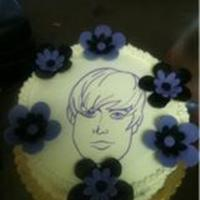 Justin Beiber My niece wanted a Justin Beiber Cake. I drew his face using edible Marker and a sugarsheet. I covered the cake with buttercream and the...