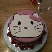 Hello Kitty   This is a strawberry cake with the strawberries and cream filling. Crumb coated and covered with Fondant.