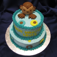 Two Tiered Monkey Cake   buttercream icing with fondant rice krispy monkey with fondant accents