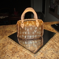 Purse Cake   Fondant covered purse cake! Everything edible :) I think it turned out pretty good for my first time!