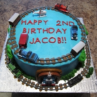 Thomas The Train Cake   buttercream icing with Thomas the Train figurines on top