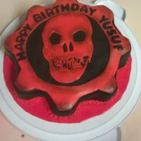 Xbox Game Gears Of War cake: made with marshmallow fondant and white cake and strawberry inside. Made it for a little boy's birthday, he love...