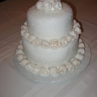 Kim's Wedding Cake Round, two tiered cake make with sugar crystals, fondant, and fondant roses.