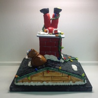Santa Stuck In The Chimney! This cake was for a class of 2nd graders. I hope they liked it. Rice Krispy chimney, gumpaste Santa.