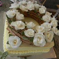 Cake Wreath This was made for someone who does flower wreaths as a hobby and recently did one with just white roses. Roses are MMF.