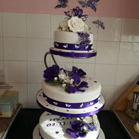 Purple Vanda Orchids And White Roses With Butterflies This Was The Brides Stand I Persuaded Her To Change To An Offset Set One For The Actu... purple vanda orchids and white roses with butterflies ,this was the brides stand i persuaded her to change to an offset set one for the...