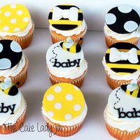 Bay Bee Shower Cupcakes Someone Purchased For A Gender Neutral Shower Cupcakes Are Lemon With Strawberry Filling And Cream Cheese Icing Th... Bay-Bee shower cupcakes someone purchased for a gender neutral shower. Cupcakes are lemon with strawberry filling and cream cheese icing....