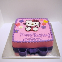 Hello Kitty Birthday Cake Buttercream cake with fondant decorations. I need to work on my writing...