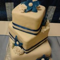 Chelsey & Josh   My first square cake. White gum paste roses, and attempted blue delphiniums. =)