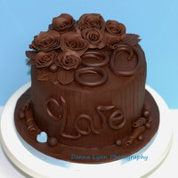 Chocolate Seduction This is a dark chocolate cake filled with dark chocolate buttercream and covered with chocolate ganache. All of the decorations are...