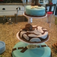"Tiered Cowboy Cake Made for baby shower (initials ""LH""). Cakes iced with cream cheese icing. Decorations made with MMF."