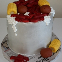 Crawfish Boil Buttercream with fondant crawfish, corn and potatoes.
