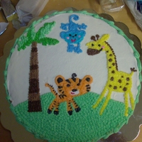 Jungle Baby Shower Cake This cake was made to match the Fisher Price Rainforest Baby Shower plates, napkins, etc.