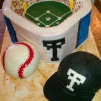Titans Baseball Stadium Stadium, baseball, and hat are covered with modeling chocolate. Hand painted Titans logo on back.