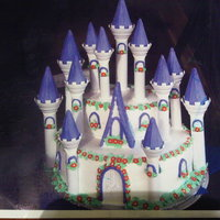 Prinsess Amber Cake Castle cake Decorated with royal icing on the pillars Sugar flowers ,sugar leaves