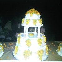 Winter Land Cake 7 tier cake Decorated with 800 yellow sugar leaves.