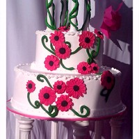 Pink Margaritas & Pice Of Art 3 tier chocolate Vanilla cake with mocha fillingCake decorated with hot pink sugar Margaritas Decorated with green sugar vines And eddible...