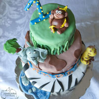 Jungle Cake  Heres a jungle cake I did for my sons first birthday. Greatly inspired by the jungle cake by JewelldCakes (Thanks for helping me...