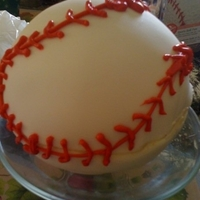 Baseball First attempt at using the sports ball cake pan. The fondant did not cooperate.