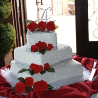 Buttercream Wedding Cake I made this cake for my nephew's wedding. Made and transported the Gumpaste roses to Las Vegas! Added edible bling and edible glitter...