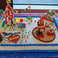 Circus Themed Birthday Cake This circus themed birthday cake was decorated with fondant animals, flags and clowns. The tent is made from gumpaste.