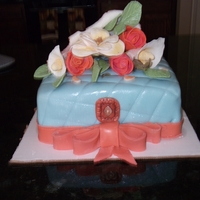 Quilted Box Cake Fondant covered cake, cameo made from fondant and impressions, and gumpaste flowers and hankie.