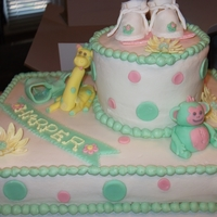 Animal Baby Shower Cake Fondant crafted animals and baby shoes.