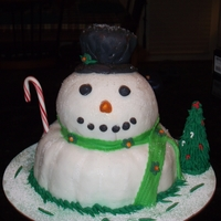 Snowman Cake I used a bundt cake for the bottom, ball cake for the center, and mini bundt for the hat...all covered with marshmallow fondant. My first...