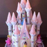Bekah's Castle A cake fit for a Princess! For my Granddaughter'f 1st Birthday. Made from Wilton (Romantic) Castle Kit. Was easy and fun to make. Two...