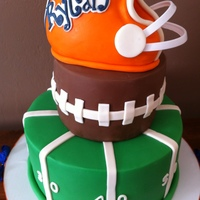 Football Birthday Cake My client sent me a similar picture off Pinterest that she asked me to make for her son's 1st birthday in combination with a tailgate...