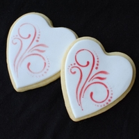Stenciled Heart Cookies My first time stenciling!! Used shortening + petal dust on fondant.