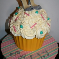 Glitter Shoe Giant Cupcake   Giant Vanilla Cupcake with handmade gumpaste shoes. Base is wilton yellow candy melts, thanks for looking!