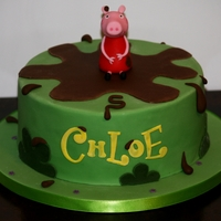 Peppa Pig  Peppa cake, chocolate cake filled with chocolate buttercream and covered in chocolate ganache. Design is by the Little Cherry Cake Company...