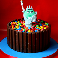 M&m's New York  Chocolate cake with chocolate buttercream, covered in kit kats and m&m's! Statue of Liberty is hand made out of modelling...