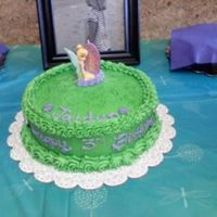 Tinkerbell I used green sparkles to look like pixie dust. I forgot to take a pic once I got the cake topper on so this is what the client sent me :)
