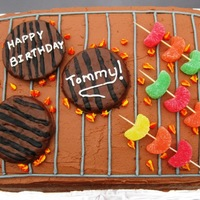 "Bbq Grill Cake This was made for a friends birthday. The ""hamburgers"" are actually sugar cookies that I coated in chocolate and then stripped..."