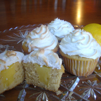 Lemon Meringue Cupcakes Vanilla cake filled with lemon curd and topped with real egg white meringue. TFL!