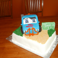 Toy Truck Cake Helped a mom of the birthday boy make this toy truck cake. We sculpted the truck on top out of cake and RKT. Bottom cake is vanilla with...